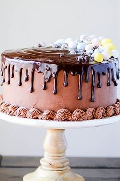 A mini cadbury egg cheesecake in between two layers of my favorite chocolate cake. Frosted with milk chocolate buttercream and topped with chocolate ganache! One of my favorite desserts to make is a c