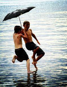 Children in the rain. My grandson has done this. Little rain can't stop their fun..