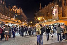 Shoppers at Christmas Market in Seville, Spain Buy Items for Nativity Scenes, Decorations, Breads and Cakes