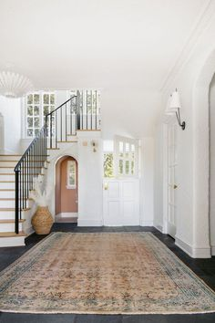 Beautiful entryway and foyer with stairway and large vintage rug - entryway ideas - entryway decor - room ideas aesthetic Natural Fiber Rugs, Dutch Door, Hudson Valley Lighting, New Week, Entryway Decor, Entryway Ideas, Modern Entryway, Entry Foyer, Beautiful One