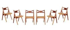 Hans Wegner Sawbuck CH29 Dining Chairs Set of 6  Vintage 1950s CH29 Dining Chairs by Hans Wegner  This set of 6 Hans Wegner Dining Chairs are in like-new condition. Collectable and comfortable, though the fabric could use replacing as there are flaws here and there. We can re-upholster them for you for an additional fee. Otherwise, ready for shipping, delivery, or pick up.
