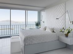 Stylish contemporary bedroom in white with sleek sconce lights