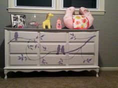 The hand painted dresser I just finished for our baby girl's room. It was a dresser from a yard sale and I painted the design on it.