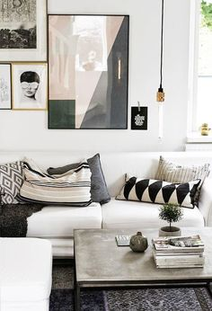 scandi boho living room with warm textiles and gallery wall
