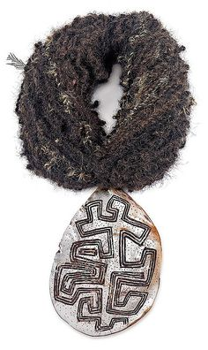 Aboriginal Artist Unknown,   An Engraved Pearl Shell (Riji, Jakoli) Western Australia Carved pearl shell, natural earth pigments and human hair string, 19.8 cm high