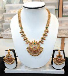 Beautiful one gram gold necklace studded with multi color stones. Necklace with chaadbali style pedant. 03 December 2017