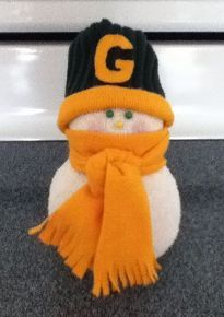 sock snow people, diy home crafts, seasonal holiday d cor, This one I made for my mother in law who is Packer fan His hat is made from the band of my husbands old thermal sock and the band from an old shirt A little hot glue is all it took Actually anything is all cut from an old shirt
