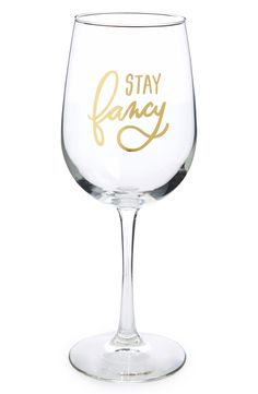 What's not to love about a wine glass that says 'Stay fancy' in golden letters?