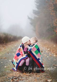 Little kids & Quilt, and I have the perfect quilt that my aunt made me for my wedding from pieces of fabric from my grandma for this. This picture WILL happen. :)