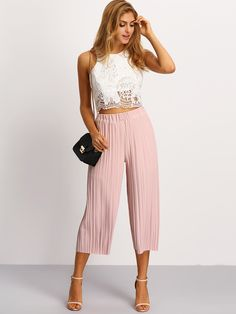 Chilled out vacay days await you in the Pleated Elastic Waist Culottes! These ultra comfy trousers feature skinny pleats, an elastic waist, and an overall relaxed fit. Pair with classic sneakers for a casual ensemble!