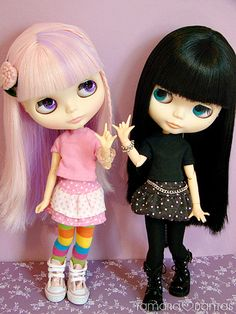 Ooooo I'm being silly now but by dark haired girl and her sister pink haired :D not crazy about faces but love colors together
