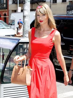 Step one: Don't actually touch the purse. The purse is not for real touching. | 13 Proven Steps On How To Hold Your Purse Exactly Like Taylor Swift