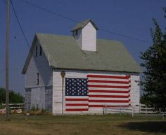 white barn with flag