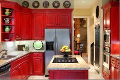 Cabinet Paint Colors: 7 Colorful Choices for the Kitchen - Red Kitchen Cabinets Love the idea of red cabinets for a country cottage. Red Kitchen Cabinets, Red Kitchen Decor, Painting Kitchen Cabinets, Kitchen Redo, New Kitchen, Kitchen Dining, Kitchen Remodel, Kitchen Ideas, Kitchen Designs