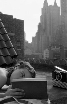 last-picture-show:Lisa Larsen, Reading on the Roof, New York,...