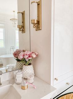 Christine Andrew from Hello Fashion shares 7 tips to get you in the mood for date night before you even step out the door! Hello Fashion Blog, Metal Easel, Kitchen Pendants, Kitchen Backsplash, Built In Microwave, Textures And Tones, Striped Towels, Home Decor Kitchen, House