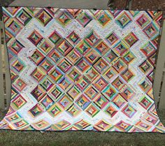 Neighbors got a new fence so I had to wait for the paint to dry and THEN I had to wait for it to stop raining and dry again before I could get Fence Photos of Alexis's Quilt. Made for a dear friend who I used to babysit when she was tiny but whom I've come to adore as an adult.