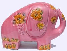 We had similar banks. Wonder if my big sis remembers?  Vintage 1960s Pink Pottery Elephant Bank - Made in Italy. $65.00, via Etsy.