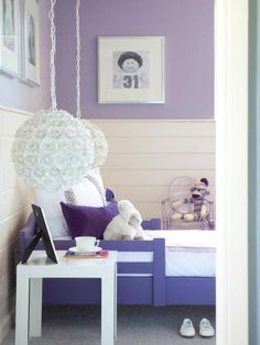 An overall dreamy aesthetic draws people into Madeline's bedroom. Horizontal planks of pine were given a lighter appearance by a custom whitewash finish. The walls and ceiling were painted a chic shade of lavender from Sherwin-Williams called Ash Violet.