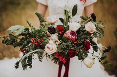 The most romantic wedding bouquets are large, lush, and full of beautiful blooms. Try unexpected fillers like eucalyptus or a sprig of berries for a stunning arrangement. Photo by Cecilia Harvard.