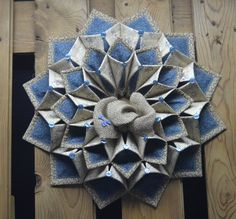 19 winter foldn stitch wreath done in country primitive snowman fabric. Accented with a burlap bow.