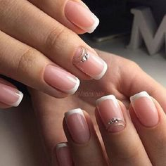 Simple French Tip with Enhancement. Keep it simple with this simple french tip nail art and a unique enhancement.