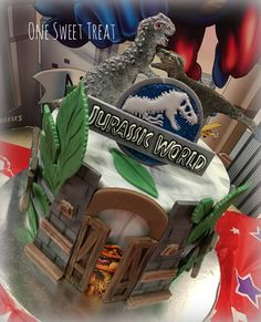 Jurassic World birthday cake. #JW #JurassicWorld #OneSweetTreat #dinosaurs #dinosaurcake