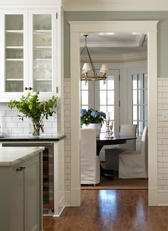 I love a clean white kitchen, but if I had to add a color, this is a good choice (soft sage grey/green)