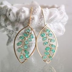 .........everyday in green.......... Made to order with a two week turnaround. 20 gauge 14k gold filled wire lengths were hand forged into leaf style earrings. Adorned with wire wrapped vines of emeralds..which are an aqua green. Finished length is just under 1 3/4. Thank you, Tracey More bella jewels vines::: http://etsy.me/2jjgKVd Leaf earrings: http://etsy.me/2lr6tny Hoops: http://etsy.me/2fdOjkY Earrings: http://etsy.me&#x...