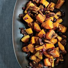 Berbere-spiced pecans add an Ethiopian twist to sweet roasted butternut squash in an orange dressing.