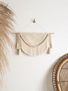 Neutral toned macramé wall hanging handmade with sustainable maple wooden beads and completed with chunky tassels and fringe. #minimaliststyle #nurserydecor #macramewallhanging #macrame Neutral Walls, Neutral Tones, Large Macrame Wall Hanging, Macrame Design, Green Copper, Geometric Wall, Wooden Beads, Home Decor Inspiration, Nursery Decor