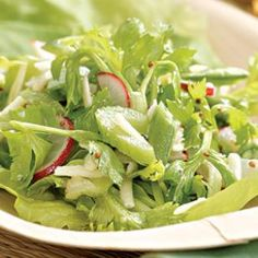 Radish, Celery & Snap Pea Salad Recipe 1 bunch radishes, trimmed, halved and thinly sliced 1 cup snap peas, trimmed and thinly sliced 1 cup thinly sliced celery 1 cup celery leaves (from about 1 large bunch) (see Note) 1 cup flat-leaf parsley leaves, coarsely chopped 3/4 cup shredded Pecorino Romano cheese 12 leaves Boston lettuce
