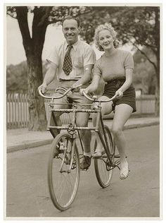 Malvern Star Side By Side tandem  , 1930's Australia..  Photo By Sam Hood. Must have been hard to balance, especially if one person was much larger than the other!