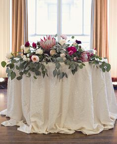 eucalyptus reception table decor | Heather Saunders Photography | Blog.theknot.com