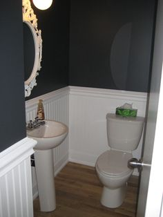 good idea for a tiny bathroom, it looks pretty with that mirror!