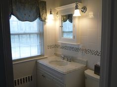 Bathroom vanity with sconce lighting. http://www.jpmoorehomeimprovements.com/our-services/bathroom-remodeling/