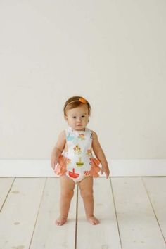 www.lemonadecouture.com   Another great website with super cute clothes for photos!  Opal Ruffle Romper