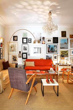 Peter Poulos has filled the dining room in his Athens apartment with vintage finds: the red sofa, chair with boomerang arms and coffee table were all found on the street.