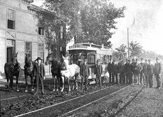 Horse-drawn street car in Minneapolis. Sign reads Sixth Street, Monroe Street and Eighth Ave. 1885