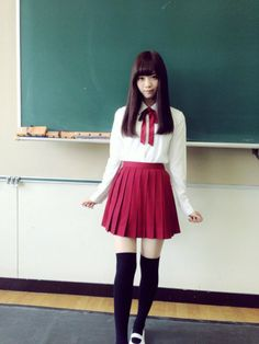 It's so rare to see an outfit like this with a solid red skirt. (Berry colored really.) Pretty.