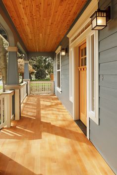 The beautiful, warm wood decking matches the front door perfectly. The blue arched supports add an air of elegance.