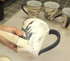 applying clear glaze gently on bisque