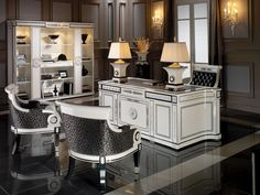 Executive desk in white lacquer with black accents, paired with an executive chair and armchairs in white lacquer with black accents and Spanish fabrics and a vitrine in white lacquer with black accents.