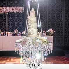 For a spectacular look a wedding cake was suspended from the crystal cake swing is available to hire through chandeliers to die for pty ltd australia aloadofball Gallery