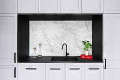 Carrara marble splashback, framed by Neolith Nero Zimbabwe. Kitchen by and . Stone Installation by . Joinery by . Photograph by Splashback, Carrara Marble, Joinery, Double Vanity, Natural Stones, Zimbabwe, Mirror, Kitchens, Frame