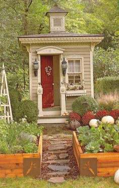 Very elegant little garden shed and raised beds. Cover photo from Country Gardens magazine (August 2012). Shed by David Wilgus.