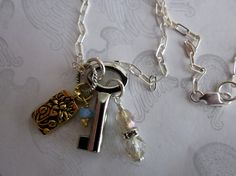 Charm Necklace with Silver key & Gold Flower on Sterlinng Chain by tuscanroad, $30.00