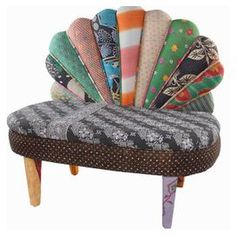 """Multicolor peacock loveseat with a mango wood frame and scalloped back. Made with reclaimed vintage kantha throws.  Product: LoveseatConstruction Material: Mango wood and reclaimed kanthaColor: MultiFeatures: One-of-a-kindDimensions: 36"""" H x 40"""" W x 22"""" D"""