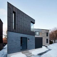 Résidence McCulloch by _naturehumaine[architecture+design] Montreal, Canada Black zinc cladding. Vertical steel screens create intimacy on the street angle while revealing Mount Royal's forest behind. Architecture Design, Minimalist Architecture, Residential Architecture, Contemporary Architecture, Estilo High Tech, Interior Tropical, Canadian House, Steel Cladding, Journal Du Design
