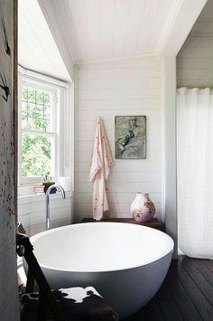 The dreamiest freestanding bathtub surrounded by crisp, white shiplap walls.